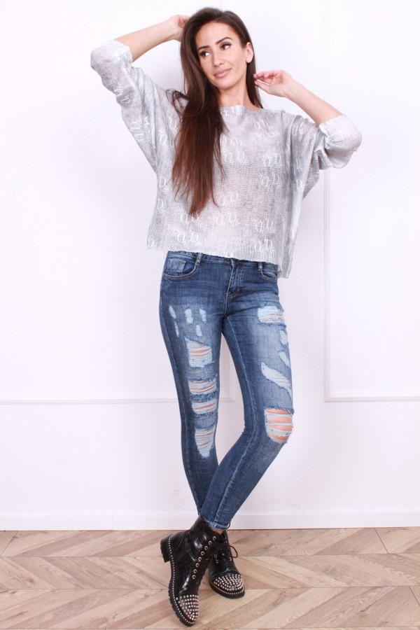 Spodnie jeansowe gniecione z dziurami